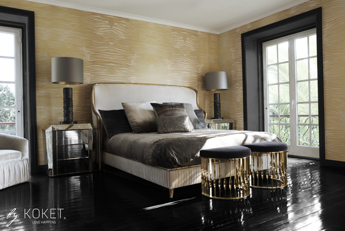 koket dream master bedroom featuring a luxury upholstered bed, mirror nightstands and gold demi-lune stools