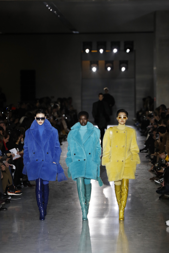 models walk the funway in colorful fur coats and matching boots at the max mara show milan fashion week fall 2019