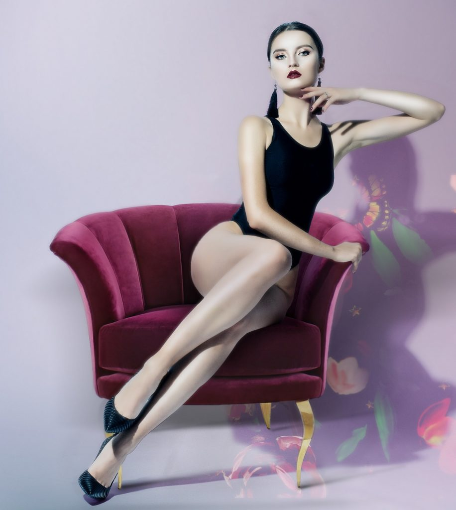 beautiful woman sitting in one of koket's sexy chairs - the besame chair
