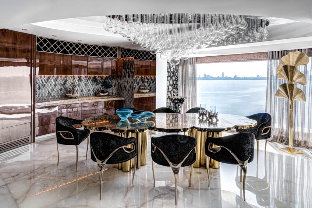luxury dining room design in an apartment in Mumbai with a boca do lobo dining table and koket chandra dining chairs designed by zz architects