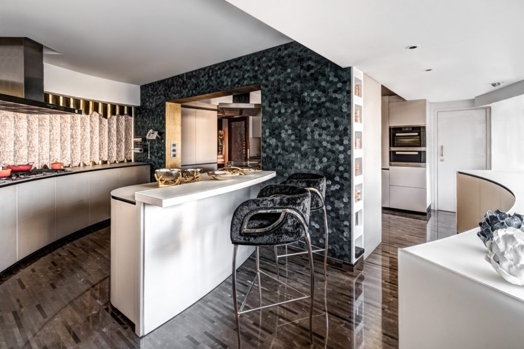 luxury kitchen design by zz architects featuring chandra bar stools by koket