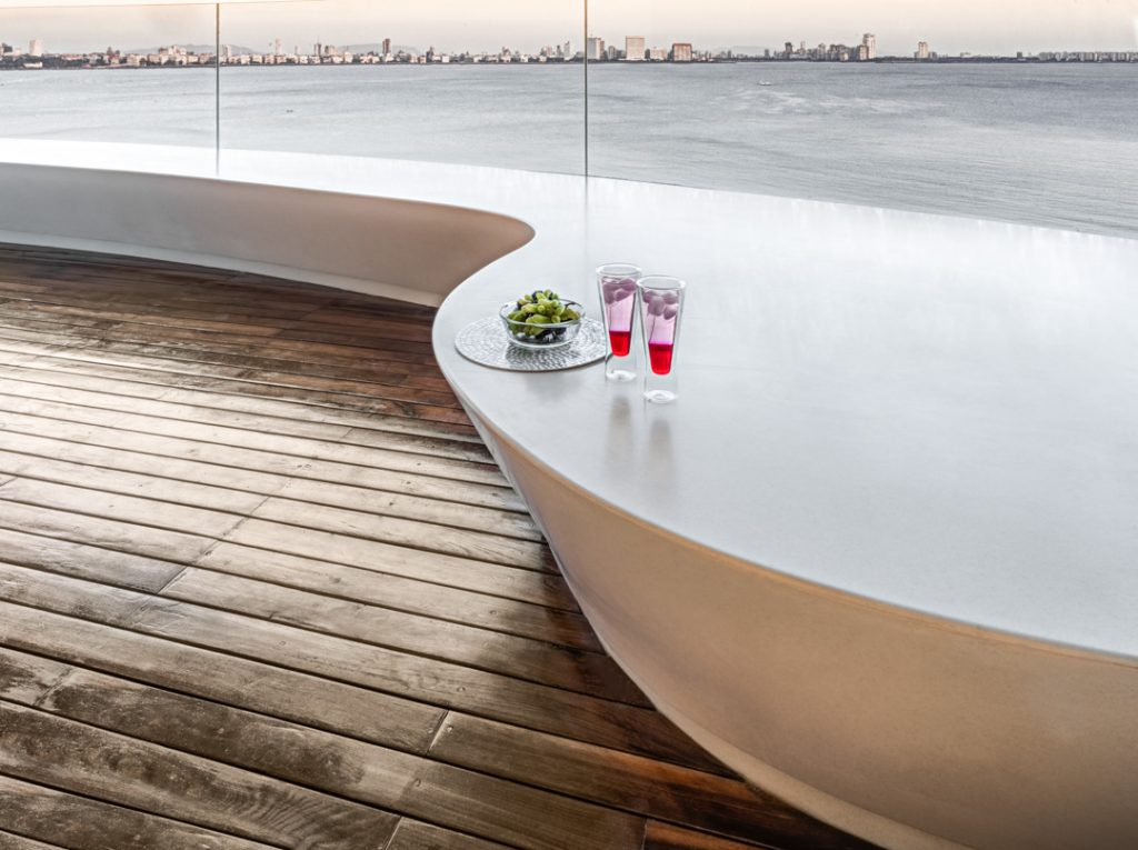 view of the queens necklace coast in mumbai from a luxury apartment designed by zz architects