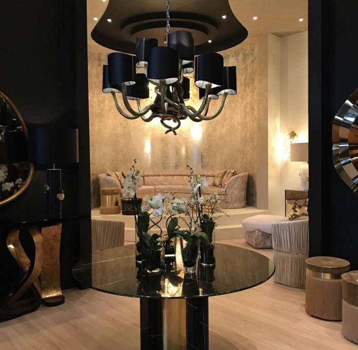 grand entryway featuring the Serpentine Chandelier, Paris Dining Table and Entince Sofa by KOKET