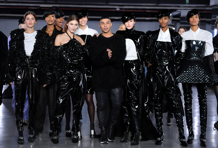 Designer, Olivier Rousteing (C) poses with models during the finale of the Balmain show at Paris Fashion Week Fall/Winter 2019/2020 Womenswear presentation