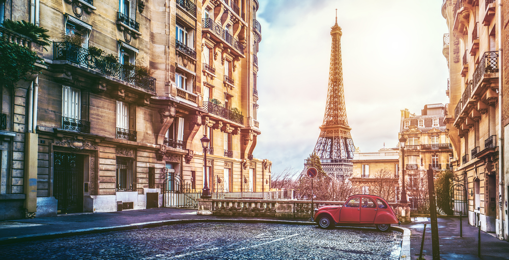 a small street in paris with a view of the eiffel tower by alexander kirch via shutterstock in Behind the Scenes at Ets Legeron with Le Connoisseur
