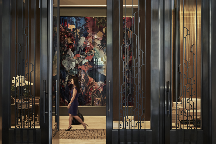 woman walking through the lobby of the four seasons new york downtown - top boutique hotels in nyc