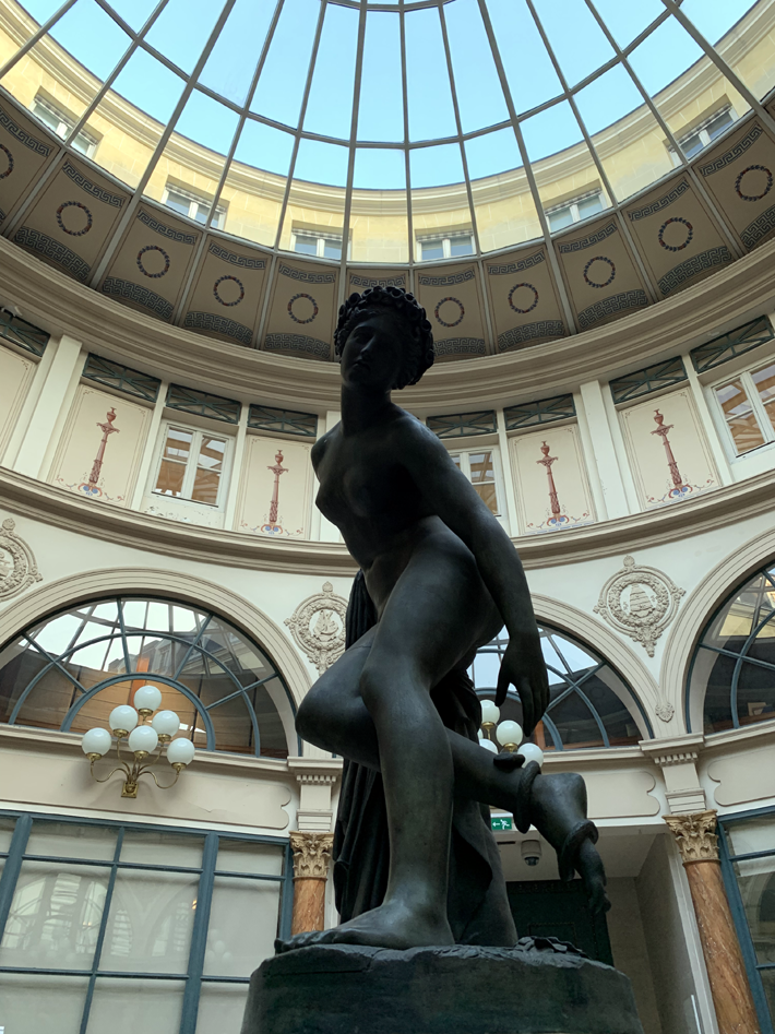 A bronze replica of Charles-François Nanteuil-Leboeuf's Eurydice mourante in the rotunda of Galerie Colbert, Paris on a tour by le connoisseur