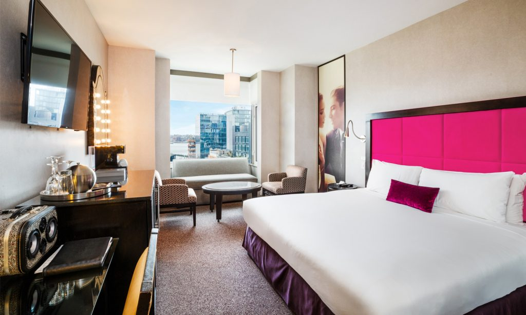 deluxe hotel room with a pink headboard at the gansevoort hotel meatpacking district - a top boutique hotel in nyc