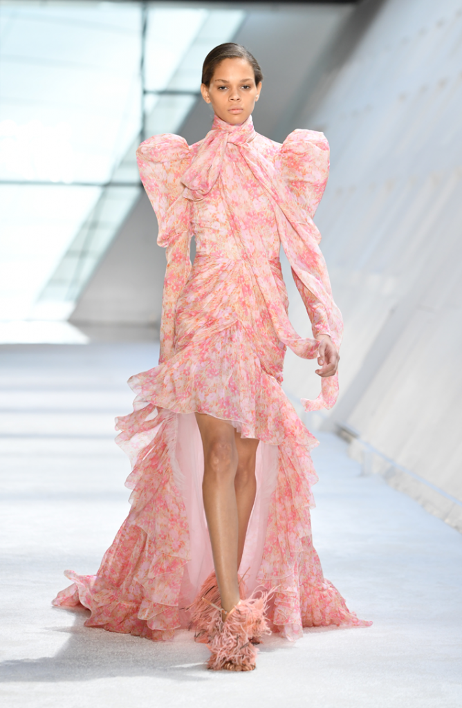 A model walks the runway in a pink floral dress during the Giambattista Valli show at Paris Fashion Week Fall/Winter 2019/2020 Womenswear presentation