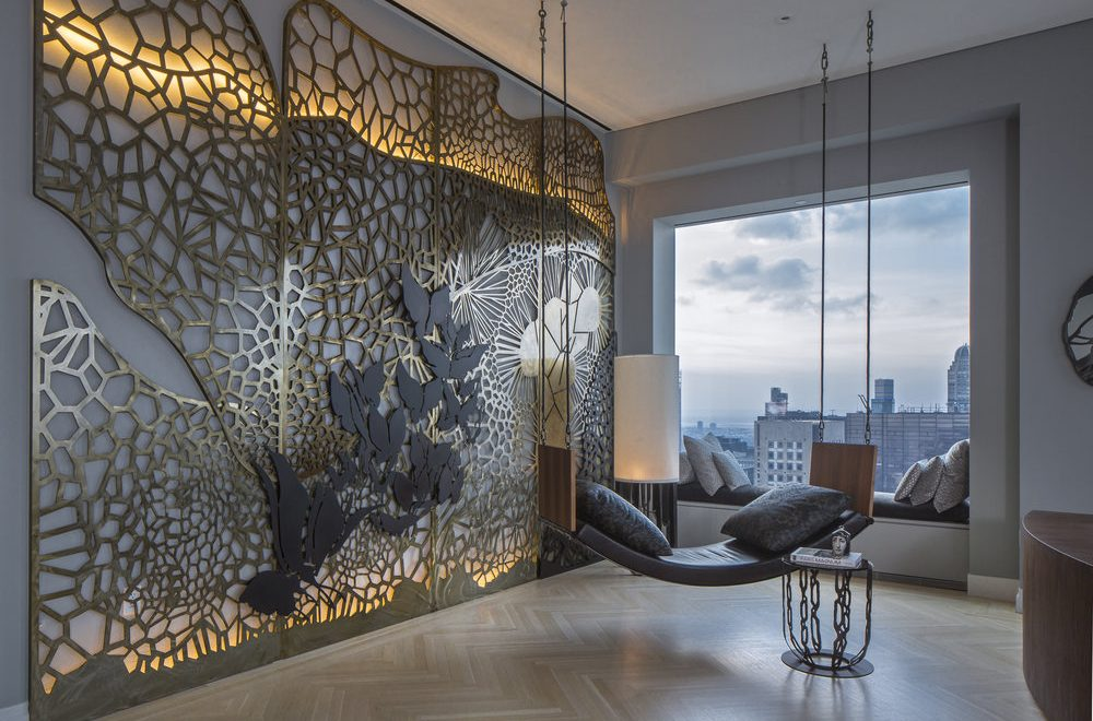 NY penthouse interior design with a metal art wall and swing by Gulla Jonsdottir - top female interior designers and architects