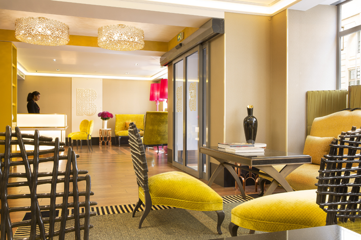 lobby at hotel baume featuring koket crystal eternity chandeliers