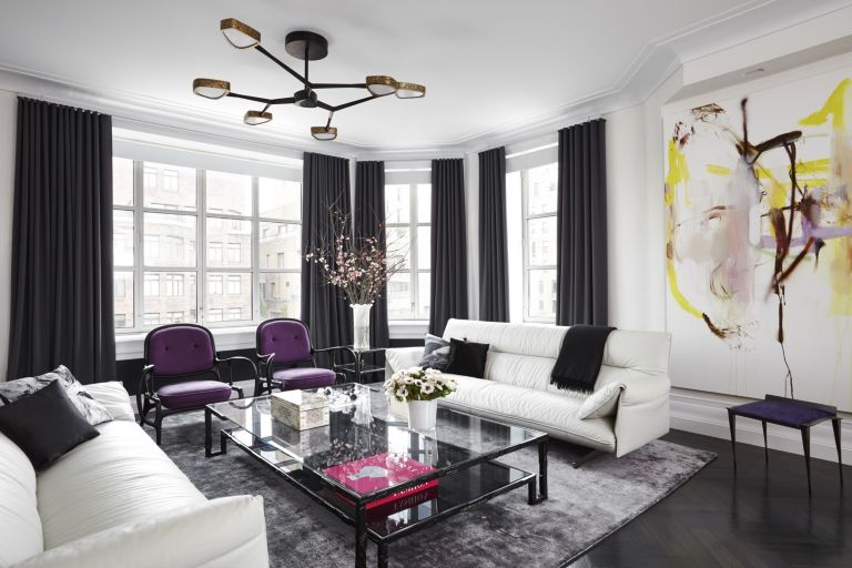 black and white living room design with purple accents by jennifer post - celebrating women's history month with top female interior designers