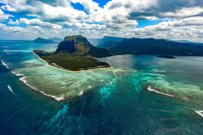 the island of Mauritius from an ariel view facing le morne - 2019 luxury destinations - Photo by Xavier Coiffic on Unsplash