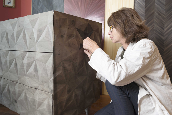 Lison de Caunes working on straw marquetry on her Commode Louxor
