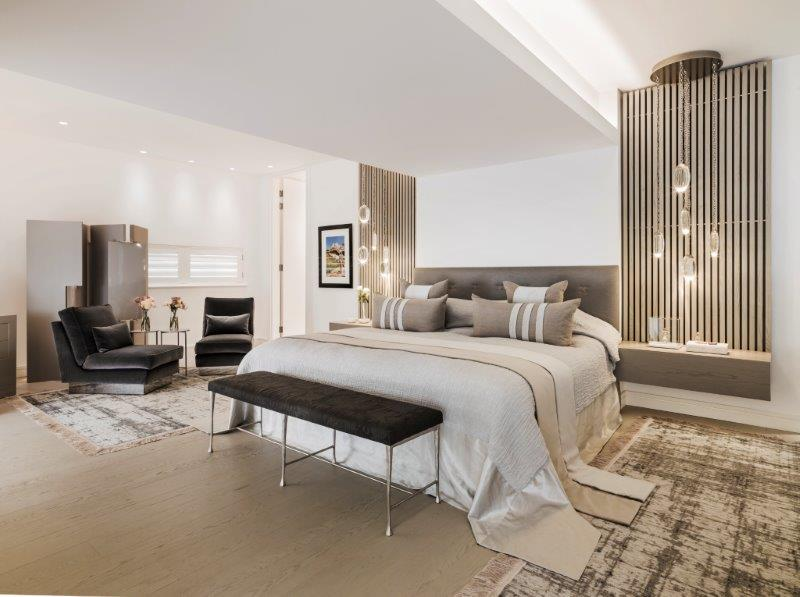 neutral toned modern master bedroom at kelly hoppen's london home - celebrating women's history month with top female interior designers