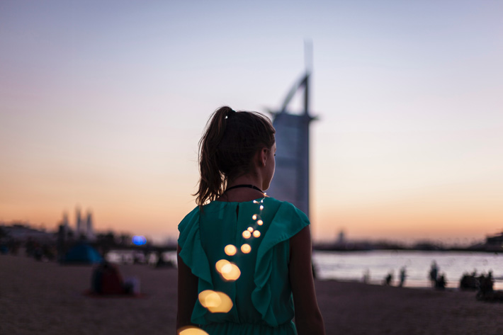 Photo of a young woman looking out over dubai - 2019 luxury destinations - photo by Adam Le Sommer on Unsplash