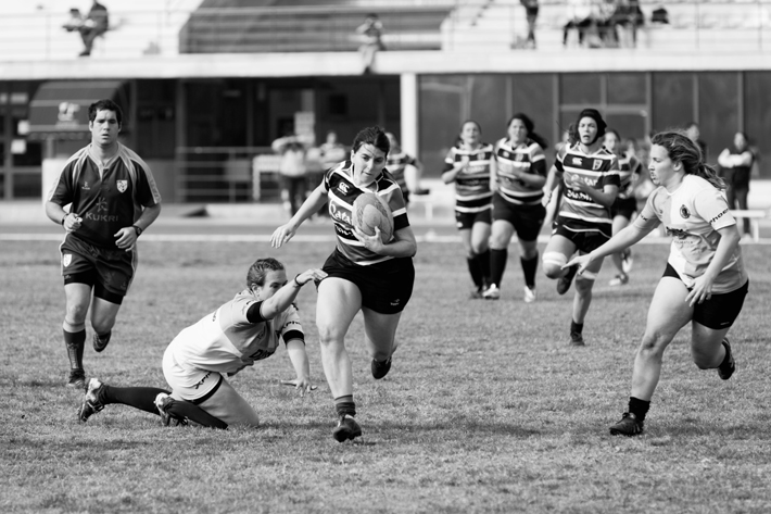 black and white Photo of women playing rugby by Brooke Lark on Unsplash - how to be a powerful woman