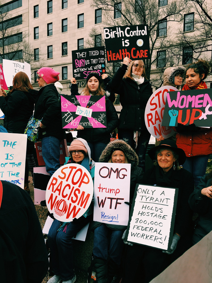 a group of women empowerment protesters holding signs