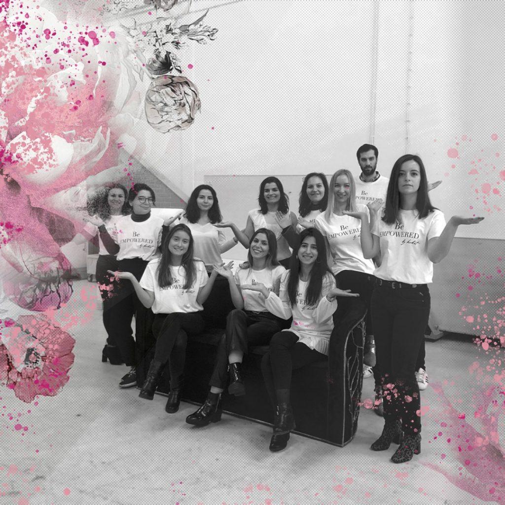 koket team celebrating international women's day 2019 with their arms raised for #balanceforbetter