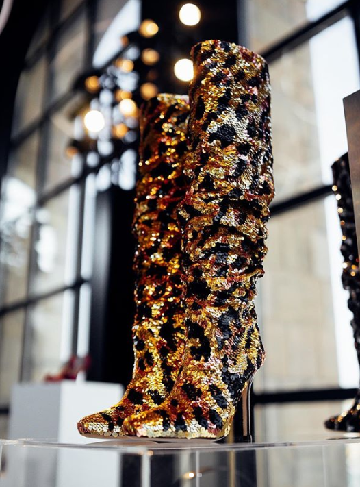 sequined tall boots by stuart weitzman displayed against the backdrop of the piazza del duomo in milan - most expensive designer shoes