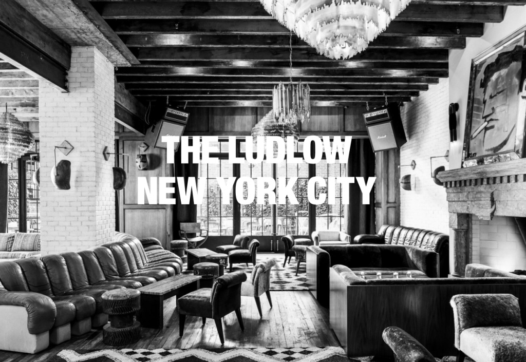 black and white image of the ludlow new york city lobby - a top boutique hotel in nyc