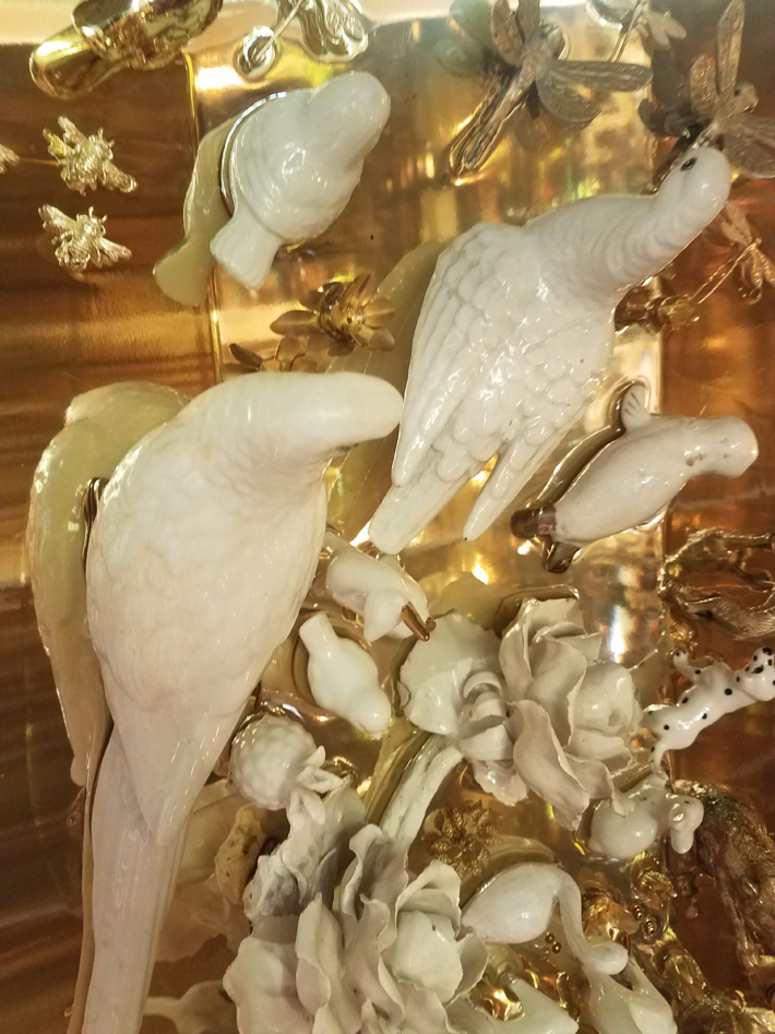 Porcelain and brass animals covered the doors of Emanuela Crotti's stunning armoire displayed at Rossana Orlandi during Milan Design Week 2019