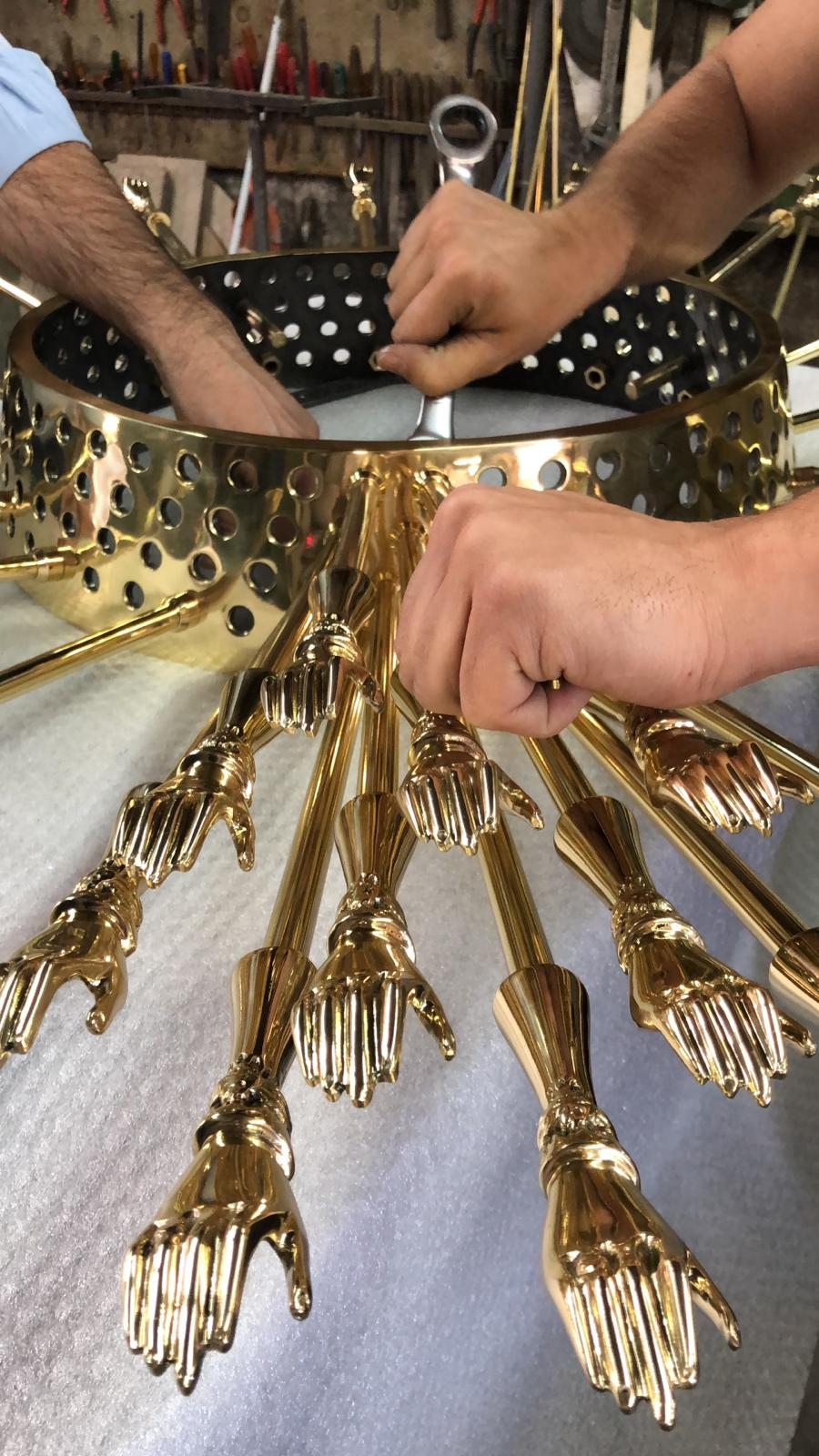 KOKET's master craftsman assembling the new Goddess Mirror. A stunning mirror featuring 200 handcrafted brass hands set to debut at salone del mobile milano 2019