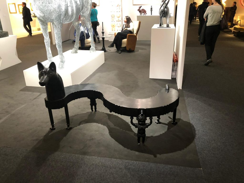 curved black bench with dog head at pad paris 2019 art and design show