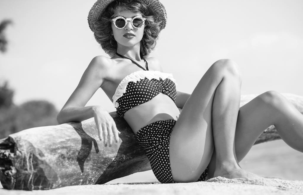 beautiful woman in vintage two-piece swimwear bikini