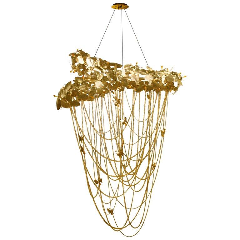 mcqueen chandelier by luxxu made of brass and swarovski crystals - camp and kitsch furniture