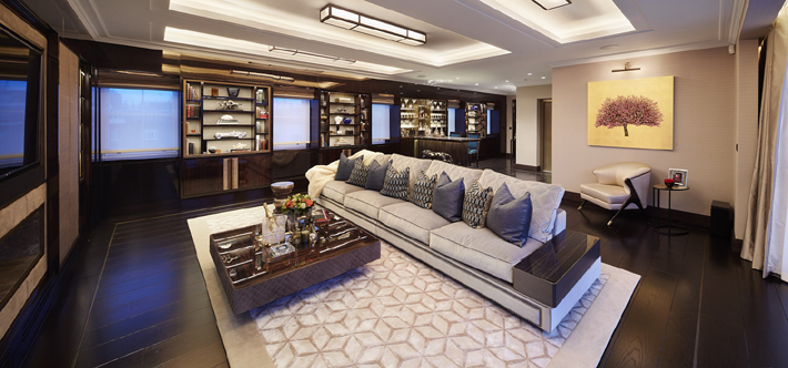 Penthouse entertainment suite designed by Fenton Whelan featuring built-in storage and KOKET's Naomi Chair. Photo by Matt Clayton.