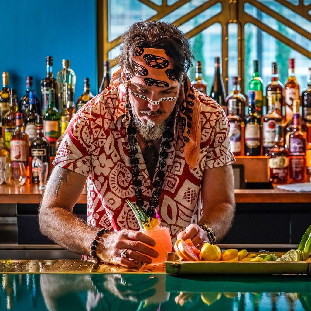 best rooftop bars nyc - bartender making drink at the polynesian tiki bar at pod 42