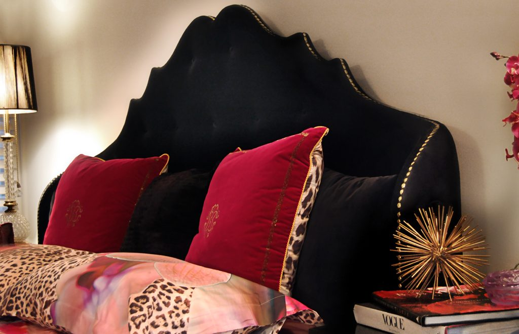 Bold Interior Design featuring Alexia bed by KOKET in black with bold red pillows