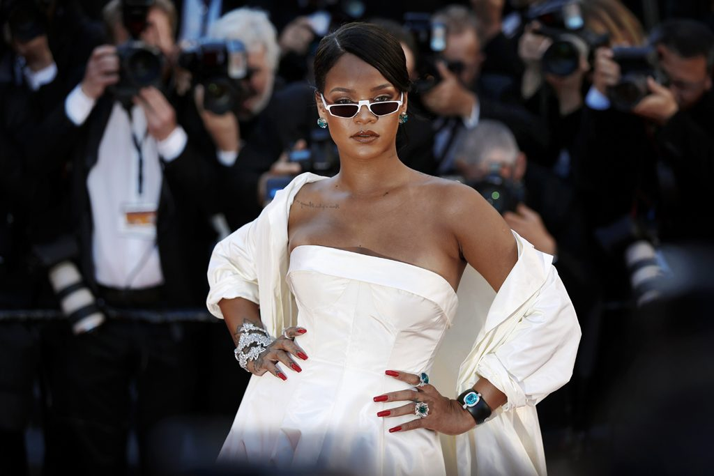 rihanna in a white dress and white sunglasses at cannes film festival 2017 - savage x fenty