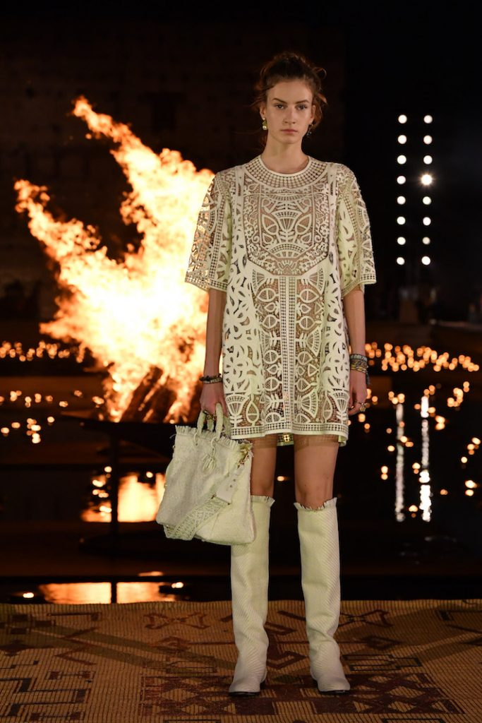 A model walks the runway during the Christian Dior Couture S/S20 Cruise Collection wearing a geometric cut out dress with matching accessories