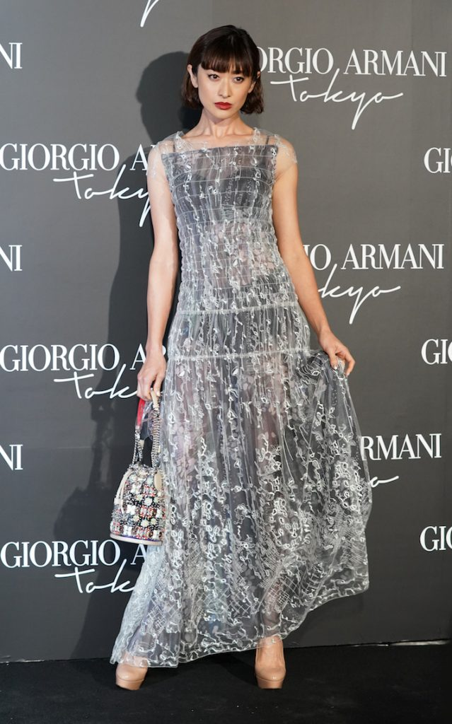 Japanese model Yu Yamada at the Giorgio Armani 2020 Cruise Collection wearing a see through embroidered dress