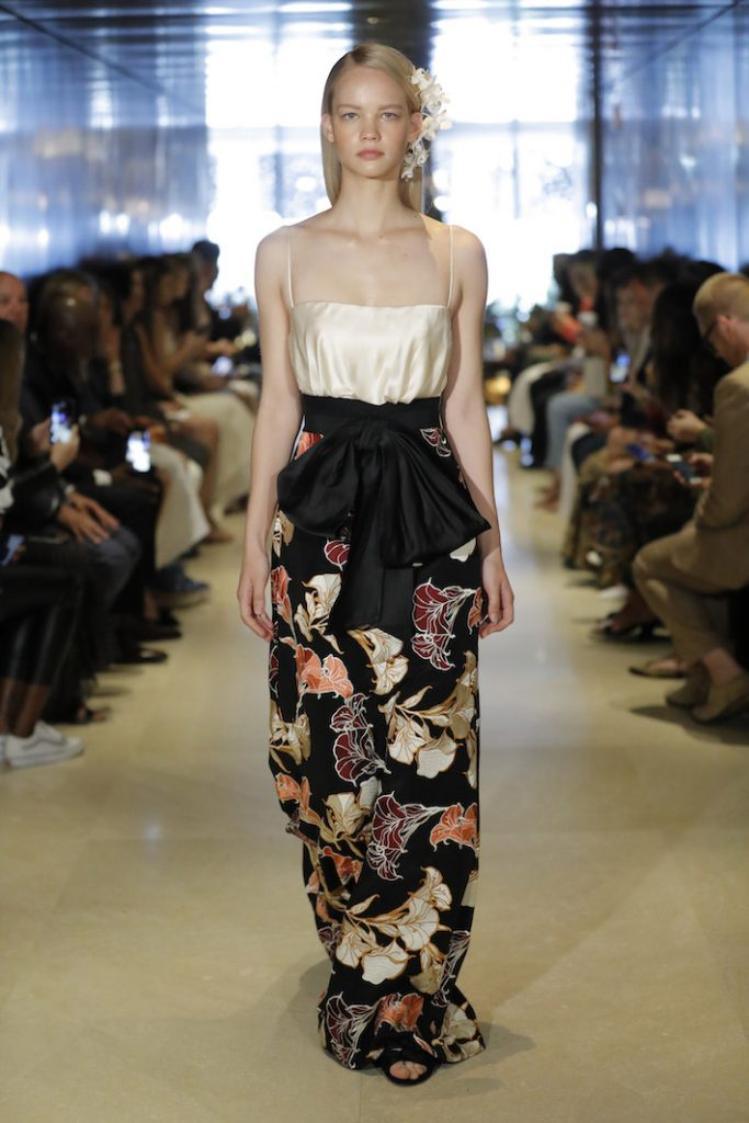 A model walks the runway during Johanna Ortiz Resort '20 Collection show wearing a floor length floral printed maxi dress