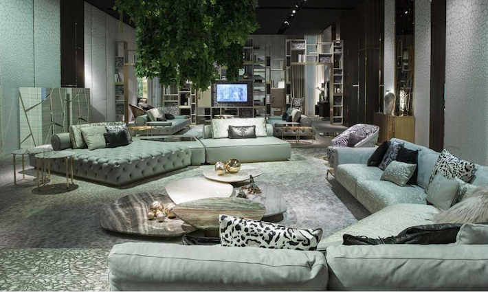 a living room setting with grey, green and pink furniture by roberto cavalli home 2019 collection