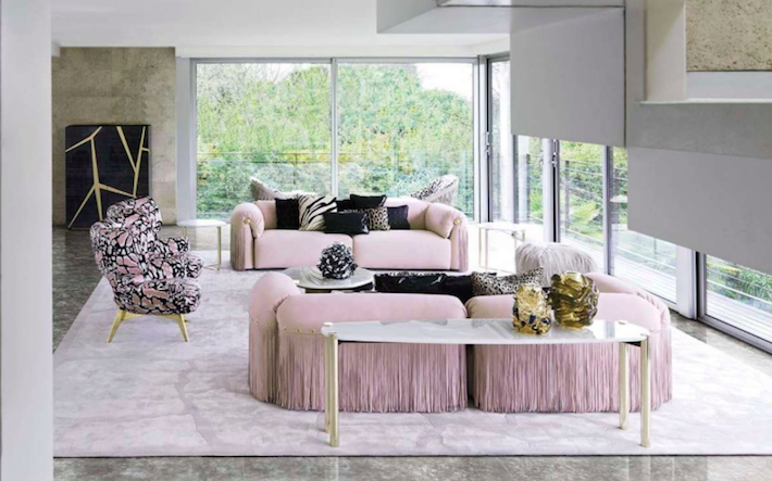 living room design with roberto cavalli home luxury furniture - pink sofas and animal print pink and black chairs