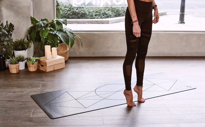 a woman doing yoga wearing leggings showing how to wear the athleisure trend