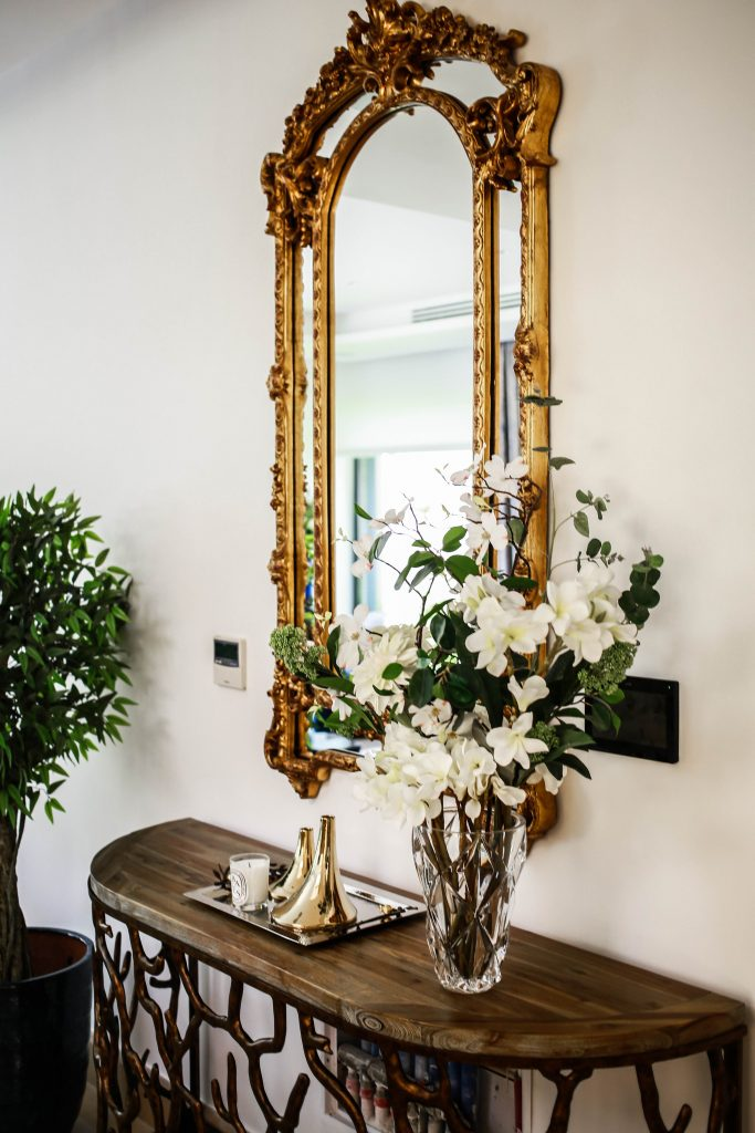 traditional console table and mirror in living room in amman based interior design project by maysoon haymoor