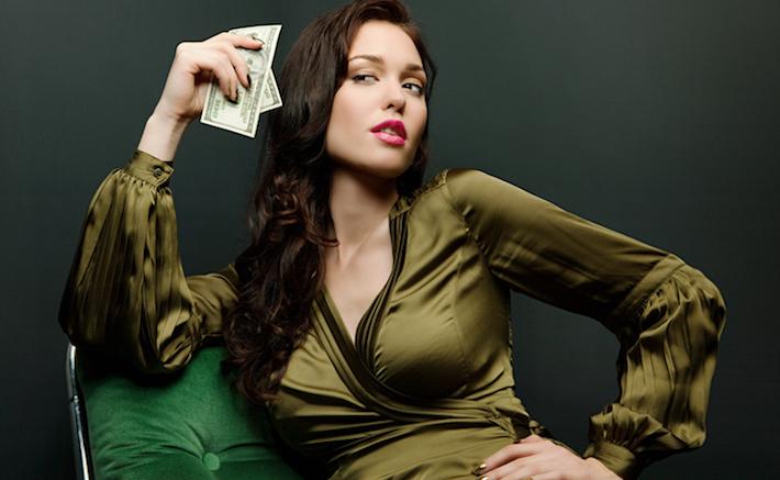 Sophisticated woman holding dollar bills