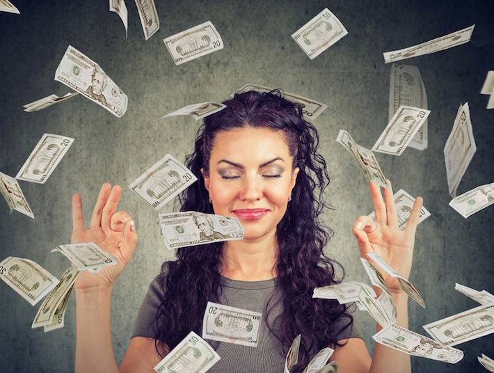Woman smiling with money raining around her - Meet Alli McCartney & UBS Alignment Partners