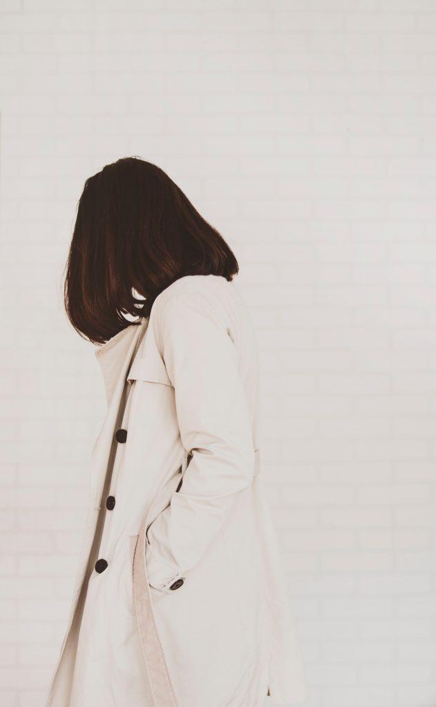 beautiful woman wearing a white trench coat