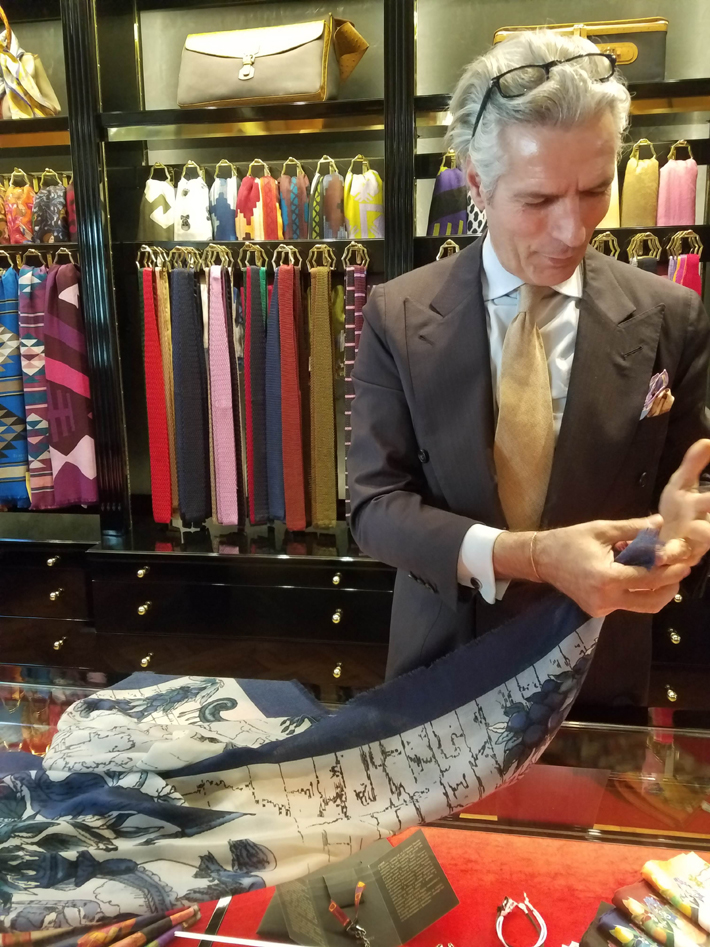 rubinacci salesman performing the ring test on their silk scarves