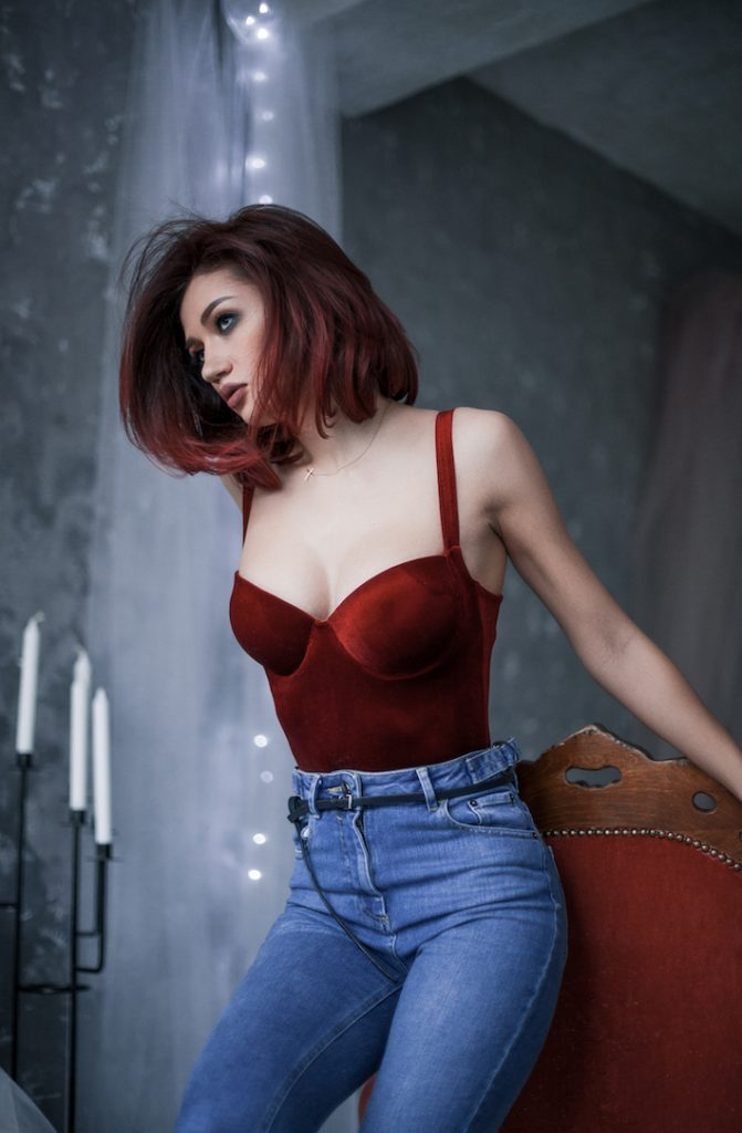 woman wearing velvet body suit with jeans - lingerie trend