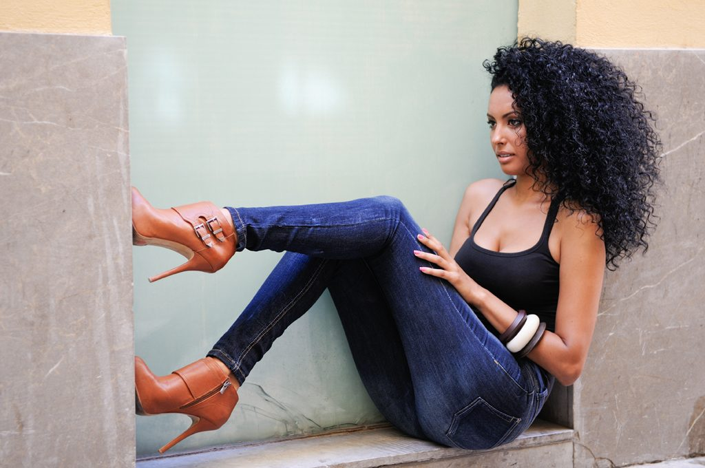 beautiful woman wearing jeans and a black tank top