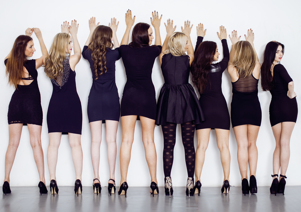fashion trends that never go out of style - women lined up in little black dresses