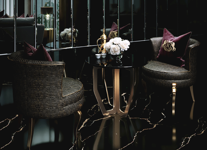 Deliciosa Chairs by KOKET upholstered in a metallic animal print linen fabric in a luxury interior by celia sawyer
