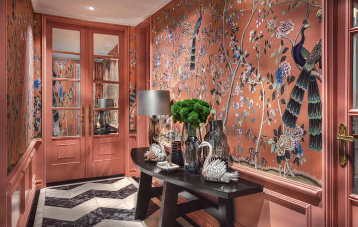 coral hallway with bird wallpaper at Casa do Passadiço Lisbon Showroom